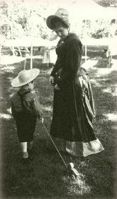 Ellie as Mrs. Potts with her son Erik as Oscero Potts