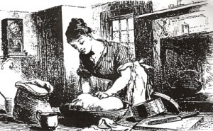 A dedicated 1850s housewife kneading bread